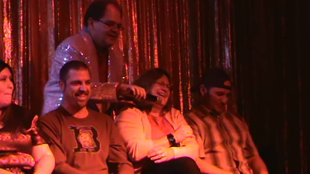 hypnotist Chris Cady with  hypnotized laughing woman in his hypnosis show