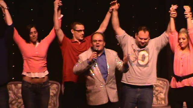 hypnotist chris cady and hypnotized convention guests bow in his comedy hypnosis show in Reno